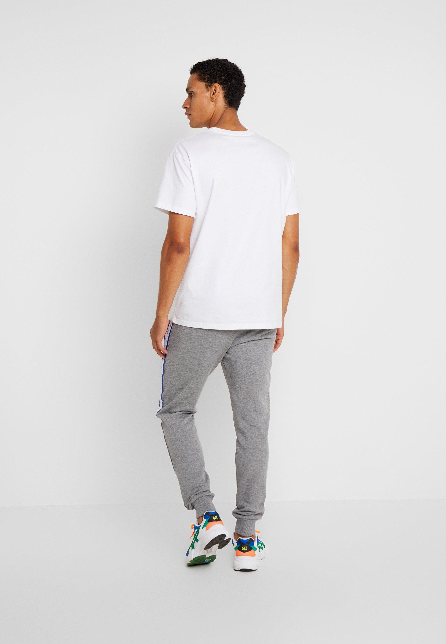 MONOGRAM TAPE PANT Pantalon de survêtement grey heatheryellow