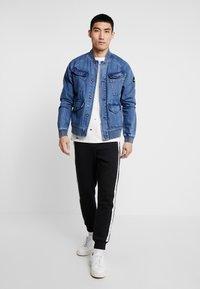 Calvin Klein Jeans - MONOGRAM TAPE PANT - Teplákové kalhoty - black/white - 1