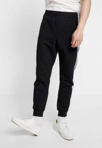 Calvin Klein Jeans - MONOGRAM TAPE PANT - Tracksuit bottoms - black/white - 0