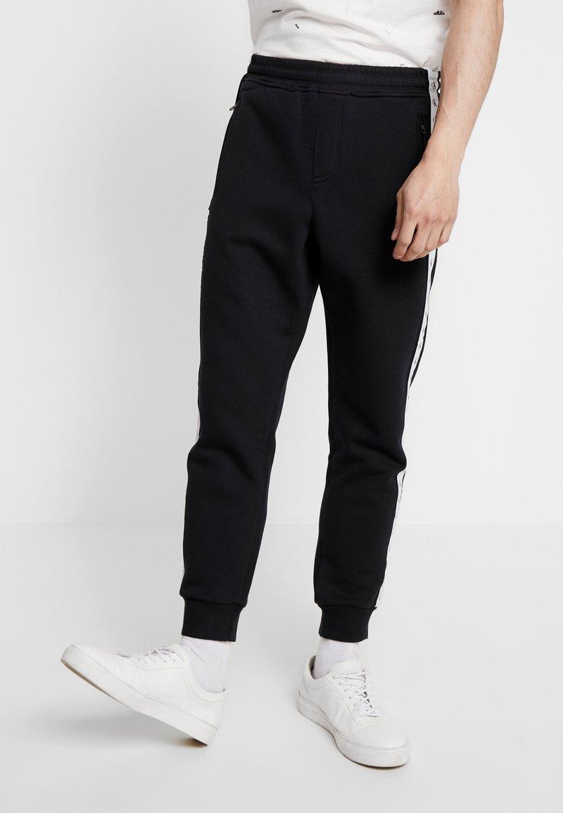 Calvin Klein Jeans - MONOGRAM TAPE PANT - Teplákové kalhoty - black/white