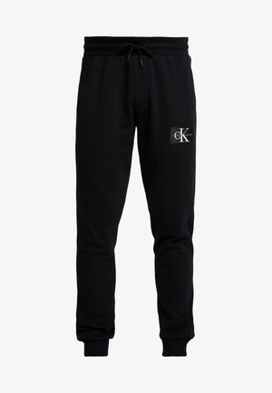 MONOGRAM PATCH PANT - Tracksuit bottoms - black