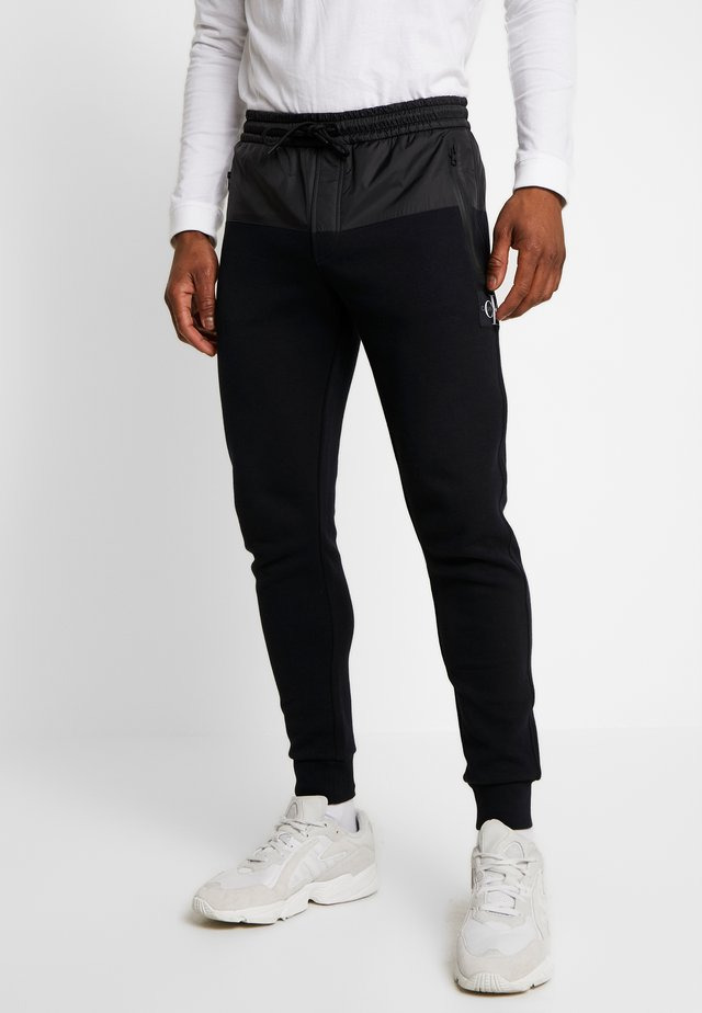 MIXED MEDIA JOGGING PANT - Trainingsbroek - black