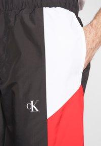 Calvin Klein Jeans - COLOR BLOCK TRACK PANT - Trainingsbroek - black/white/red - 6