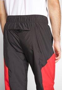 Calvin Klein Jeans - COLOR BLOCK TRACK PANT - Trainingsbroek - black/white/red - 4