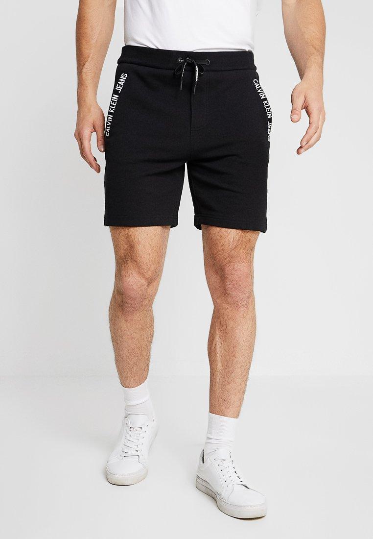 Calvin Klein Jeans - INSTIT CUFF - Pantalones deportivos - black