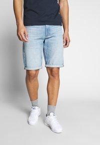 Calvin Klein Jeans - REGULAR SHORT - Denim shorts -  light blue - 0