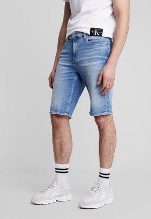 SLIM  - Denim shorts - light blue