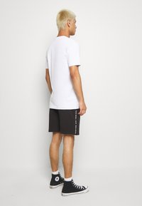 Calvin Klein Jeans - SIDE LOGO - Pantalon de survêtement - black - 2