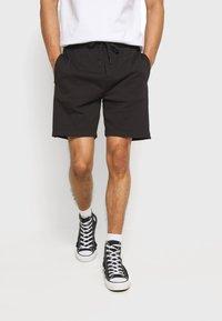Calvin Klein Jeans - SIDE LOGO - Pantalon de survêtement - black - 0