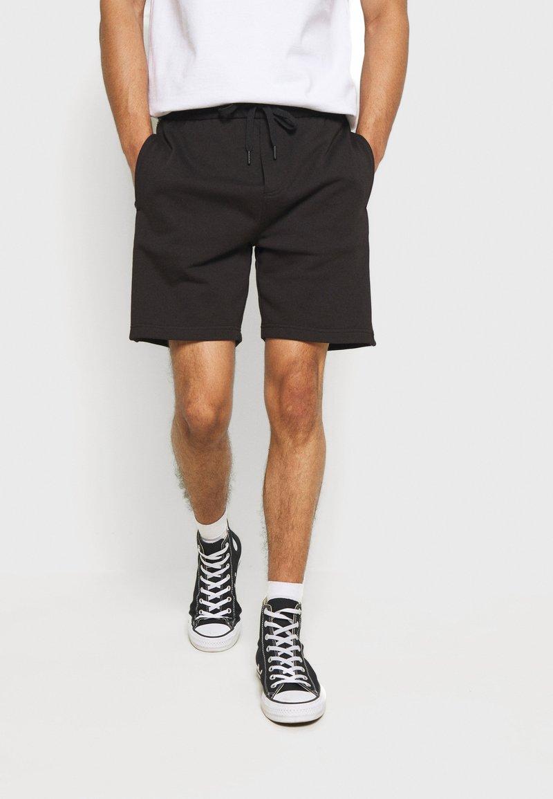 Calvin Klein Jeans - SIDE LOGO - Pantalon de survêtement - black