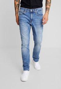 Calvin Klein Jeans - 058 SLIM - Jeans slim fit - 135 blue - 0