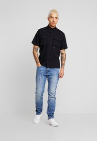 Calvin Klein Jeans - 058 SLIM - Jeans slim fit - 135 blue - 1