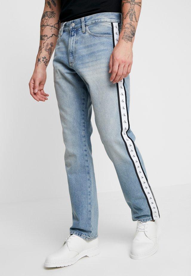 STRAIGHT - Straight leg jeans - blue