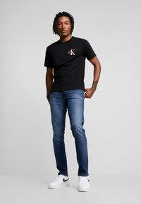 Calvin Klein Jeans - CKJ 026 SLIM - Jeans slim fit - darkblue - 1