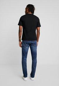 Calvin Klein Jeans - CKJ 026 SLIM - Jeans slim fit - darkblue - 2