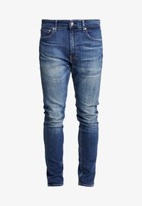 Calvin Klein Jeans - TAPER - Jeans Tapered Fit - blue - 4