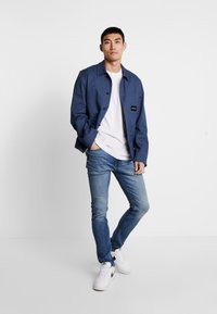 Calvin Klein Jeans - CKJ 016 SKINNY - Skinny džíny - mid blue - 1