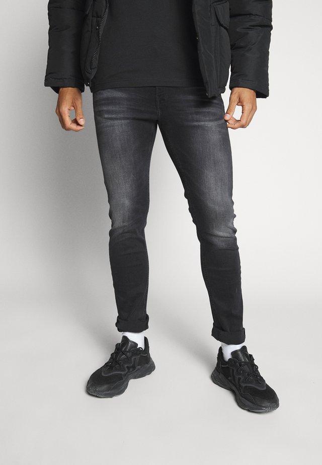 SLIM TAPER - Slim fit jeans - black