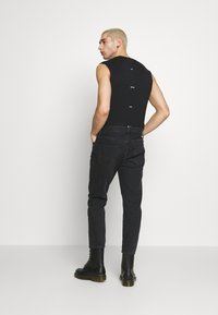 Calvin Klein Jeans - CK ONE DAD JEAN - Slim fit jeans - black stone