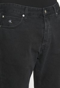 Calvin Klein Jeans - CK ONE DAD JEAN - Slim fit jeans - black stone - 7