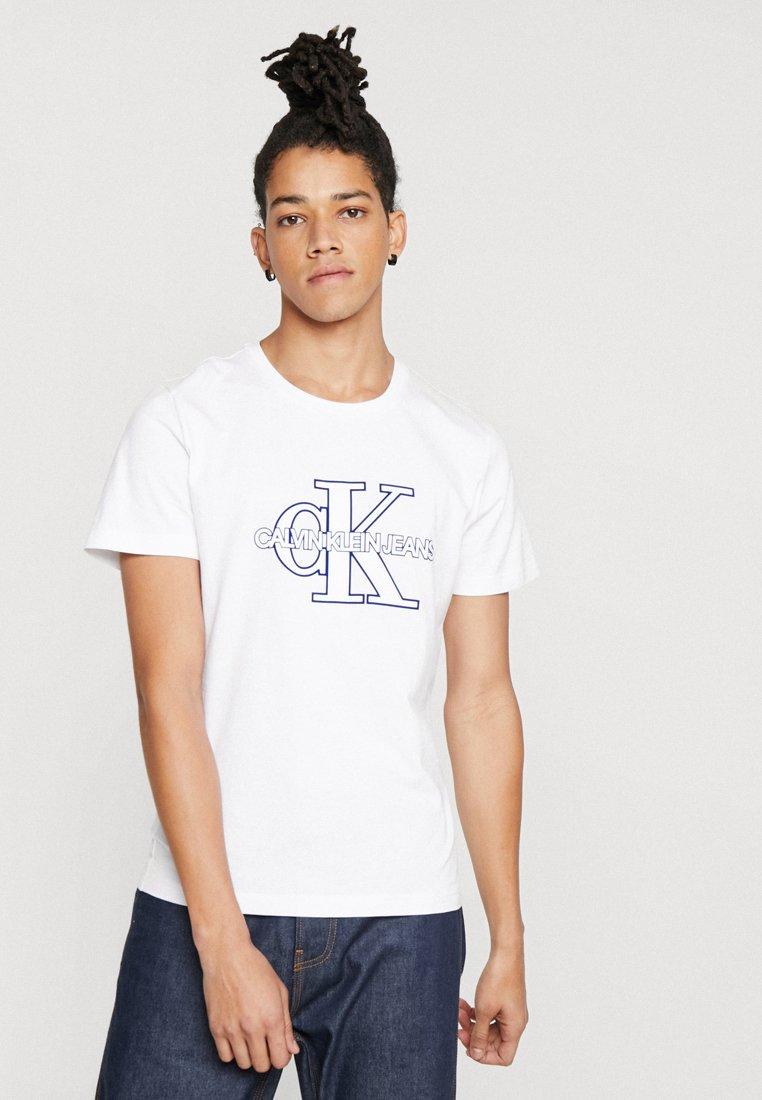 Calvin Klein Jeans - MONOGRAM FRONT LOGO SLIM - T-Shirt print - white