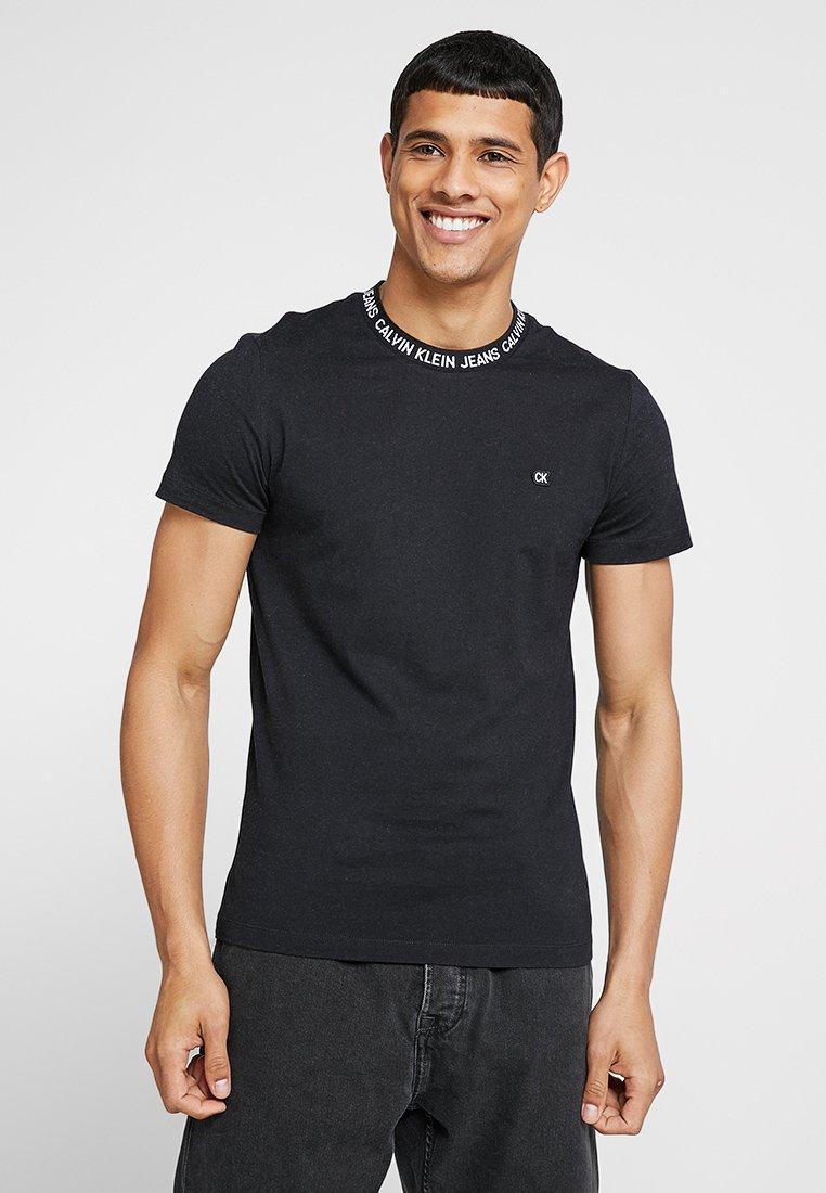 Calvin Klein Jeans - INSTIT LOGO NECK RIB - T-Shirt basic - black