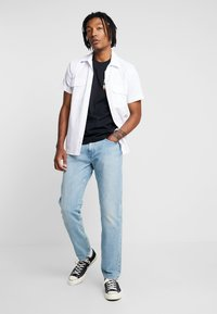 Calvin Klein Jeans - PHOTOGRAPHIC SMALL CHEST - Triko spotiskem - black - 1