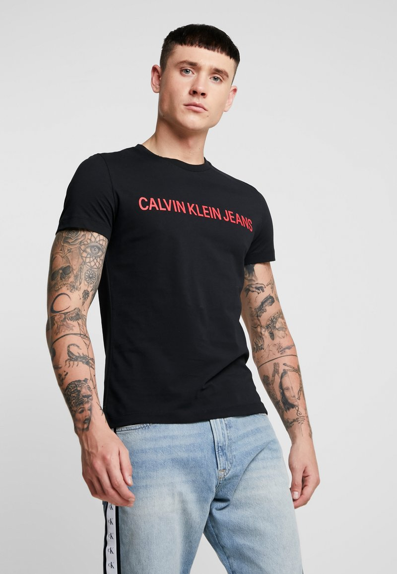 Calvin Klein Jeans - INSTITUTIONAL LOGO SLIM TEE - T-Shirt print - black