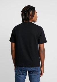 Calvin Klein Jeans - MONOGRAM EMBRO CHEST - Print T-shirt - black - 2
