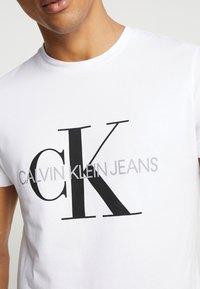 Calvin Klein Jeans - ICONIC MONOGRAM SLIM TEE - Print T-shirt - bright white - 5