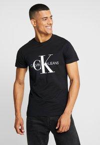 Calvin Klein Jeans - ICONIC MONOGRAM SLIM TEE - Print T-shirt - black - 0