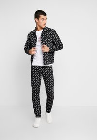Calvin Klein Jeans - SMALL LOGO SLIM TEE - Triko spotiskem - bright white - 1