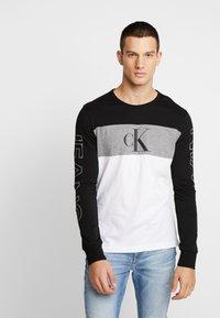 Calvin Klein Jeans - BLOCKING STATEMENT SLIM TEE - Long sleeved top - black/bright white - 0
