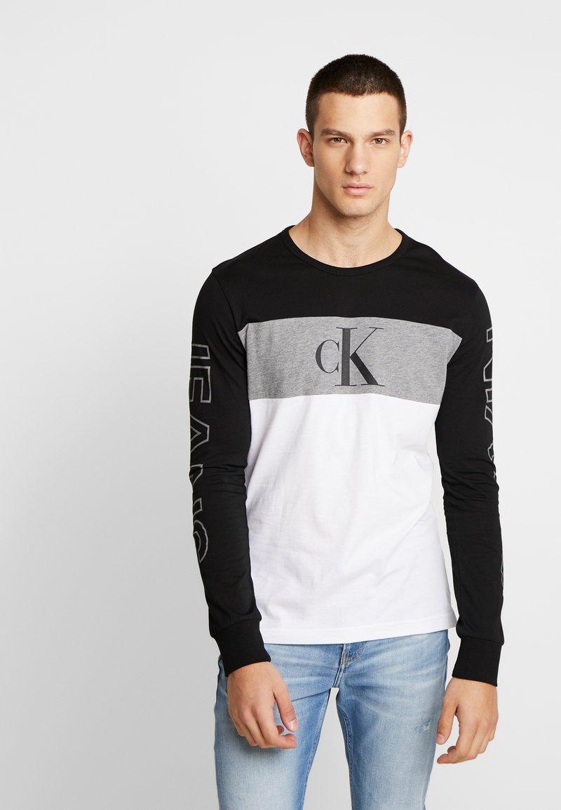 Calvin Klein Jeans - BLOCKING STATEMENT SLIM TEE - Long sleeved top - black/bright white