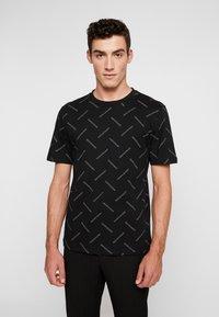 Calvin Klein Jeans - INSTITUTIONAL TEE - Print T-shirt - black/white - 0