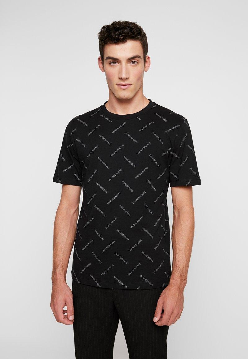 Calvin Klein Jeans - INSTITUTIONAL TEE - Print T-shirt - black/white