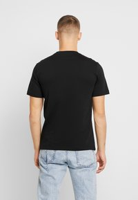 Calvin Klein Jeans - MIRRORED MONOGRAM TEE - T-shirt med print - black/white - 2