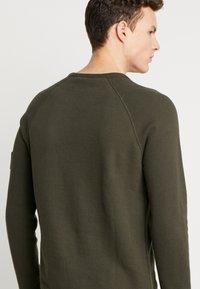 Calvin Klein Jeans - WAFFLE MONOGRAM SLEEVE SLIM - Bluzka z długim rękawem - deep depths - 4