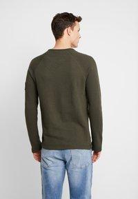 Calvin Klein Jeans - WAFFLE MONOGRAM SLEEVE SLIM - Bluzka z długim rękawem - deep depths - 2