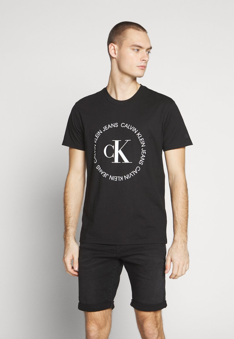 Calvin Klein Jeans - ROUND LOGO TEE - Print T-shirt - black