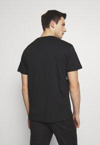 Calvin Klein Jeans - UPSCALE MONOGRAM LOGO REGULAR TEE - Print T-shirt - black - 2
