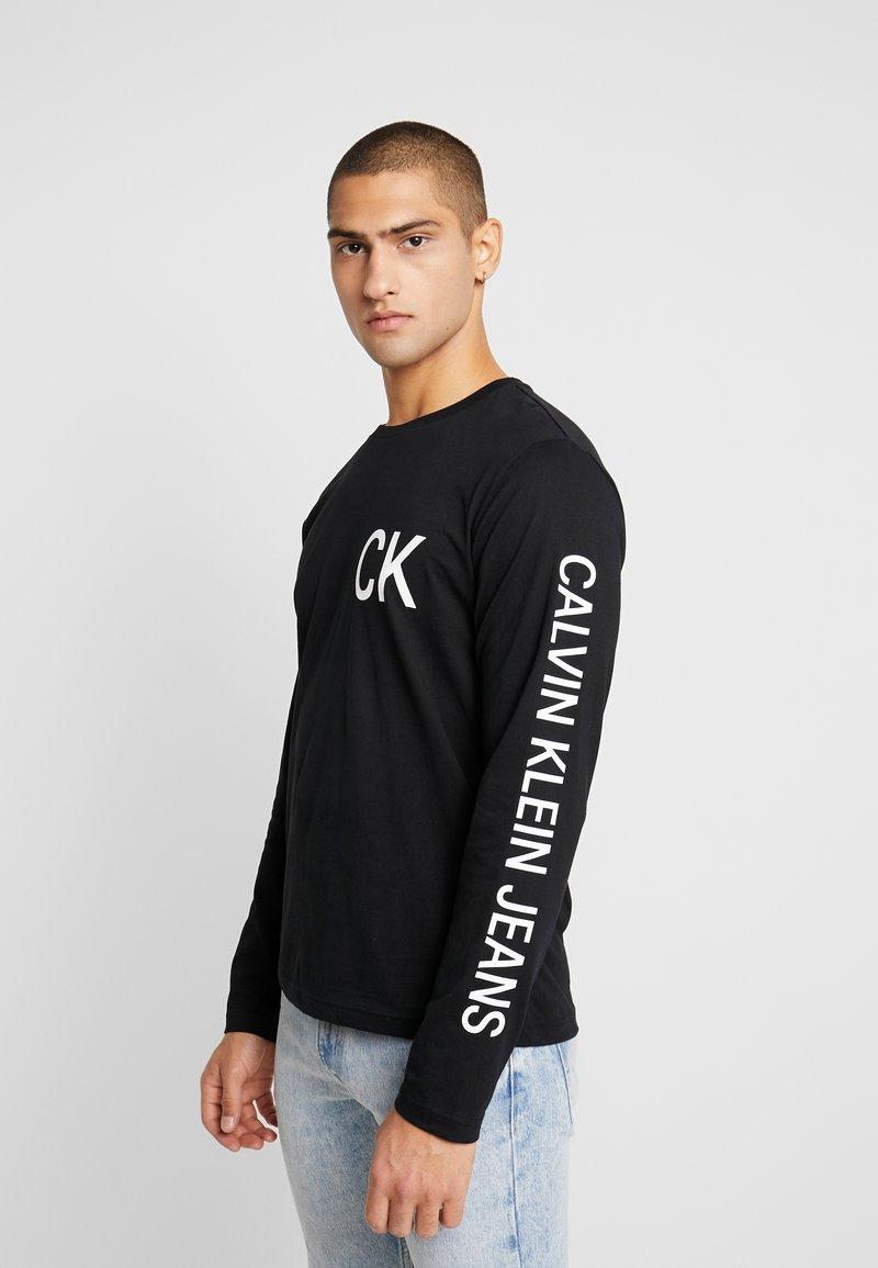 Calvin Klein Jeans - ON THE BACK LONGSLEEVE - Top sdlouhým rukávem - black