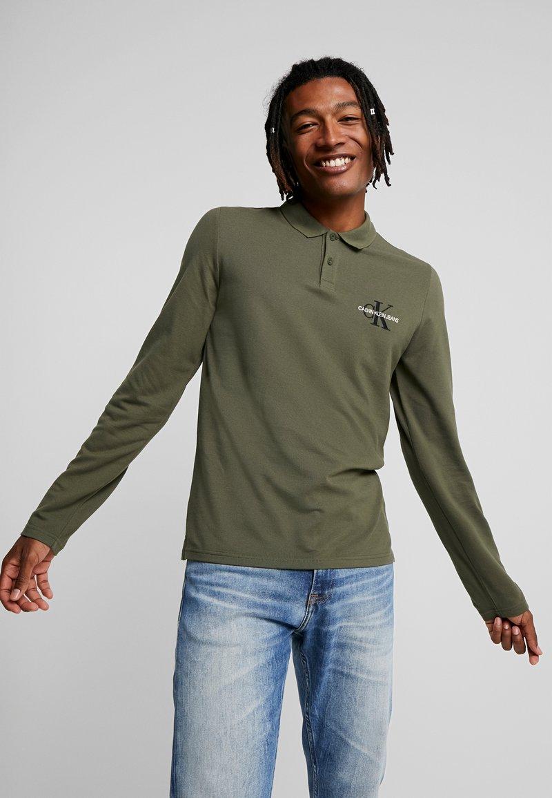 Calvin Klein Jeans - MONOGRAM SLIM FIT - Piké - grape leaf
