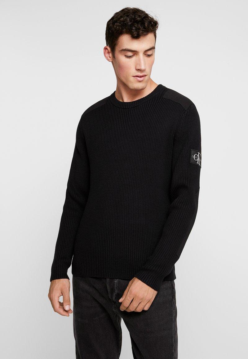 Calvin Klein Jeans - MONOGRAM SLEEVE BADGE SWEATER - Pullover - black