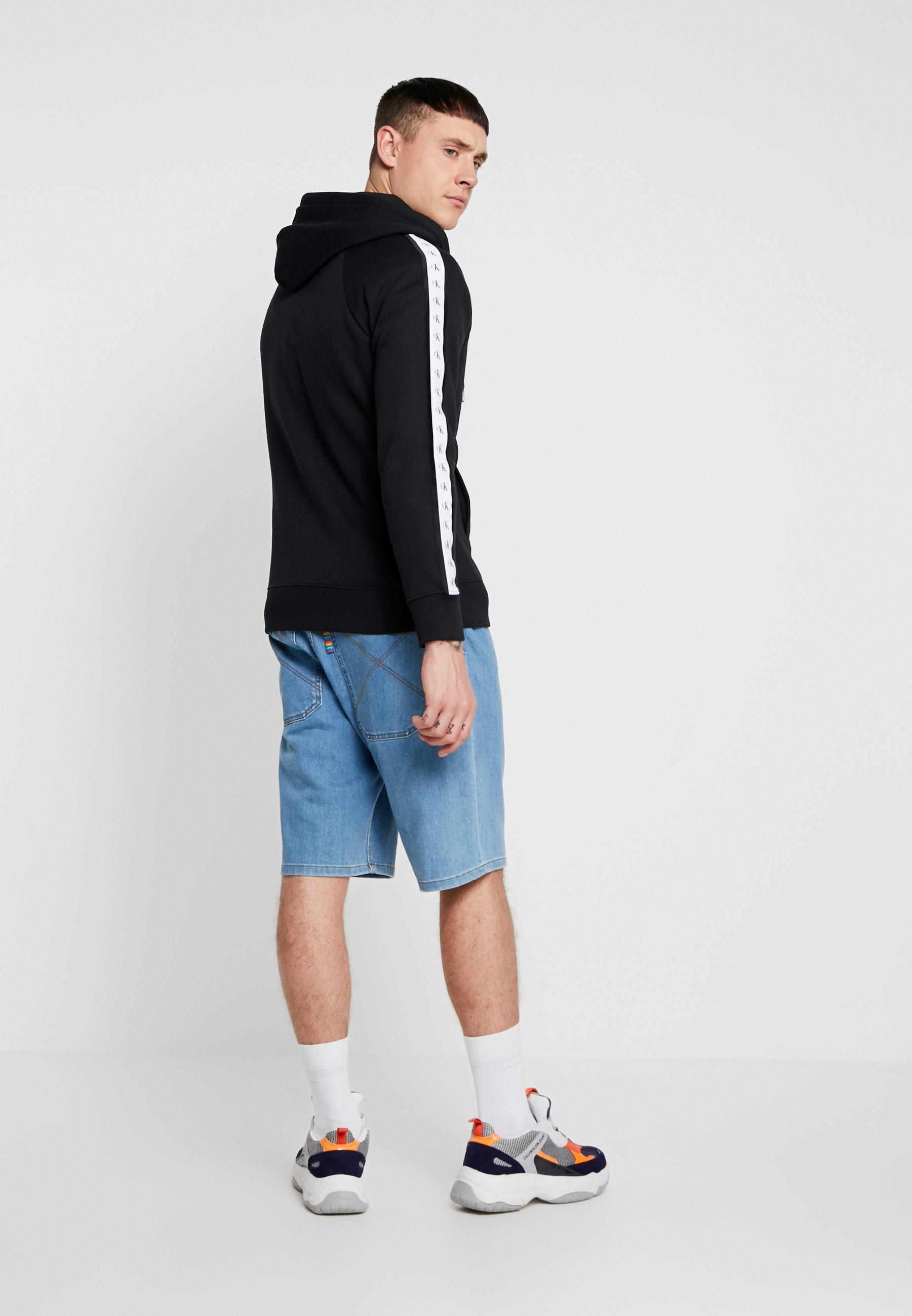 Tape Calvin Black Jeans Monogram En Zip Klein ThroughVeste Sweat Zippée b6fY7gy