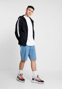 Calvin Klein Jeans - MONOGRAM TAPE ZIP THROUGH - Bluza rozpinana - black - 1