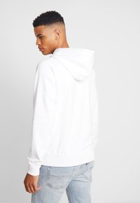 Calvin Klein Jeans - WASHED RELAXED MONOGRAM HOODIE - Hoodie - bright white - 2