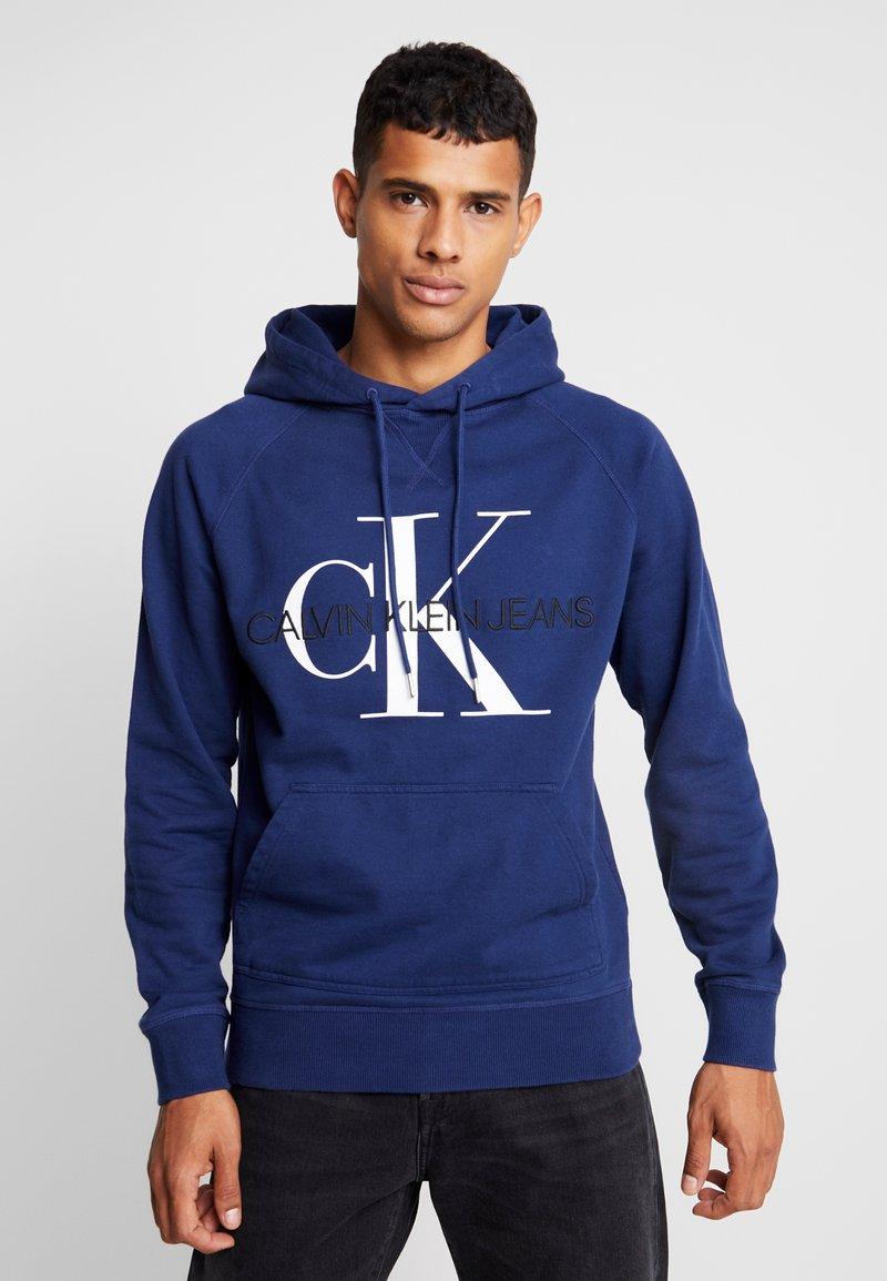 Calvin Klein Jeans - WASHED RELAXED MONOGRAM HOODIE - Hoodie - medieval blue