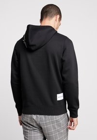 Calvin Klein Jeans - REGULAR INSTITUTIONAL HOODIE - Hoodie - black - 2