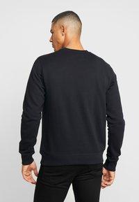 Calvin Klein Jeans - ICONIC MONOGRAM CREWNECK - Sweatshirt - black - 2